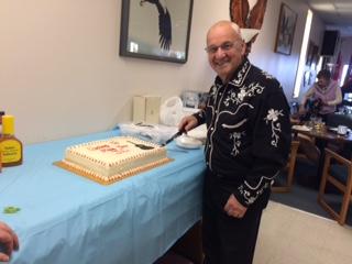 JC Faubert cutting cake