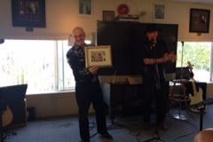 JC Faubert receiving award